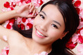 Asian beauty Girl smiling touching her face with rose background - PhotoDune Item for Sale