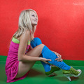 Beautiful young female photo model wearing high red boots posing - PhotoDune Item for Sale
