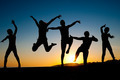 happy kids silhouettes jumping on  the beach - PhotoDune Item for Sale
