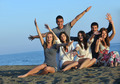 happy young  people group have fun on beach - PhotoDune Item for Sale