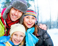 Family Outdoors.Happy Family with kid blowing Snow.Winter - PhotoDune Item for Sale