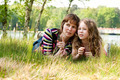 Mother and daugther relaxing in the grass - PhotoDune Item for Sale