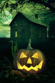 Halloween pumpkin in front of a Spooky house - PhotoDune Item for Sale