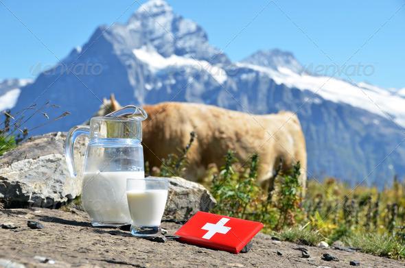 PhotoDune Swiss chocolate and jug of milk against mountain peak Switzerla 4021136