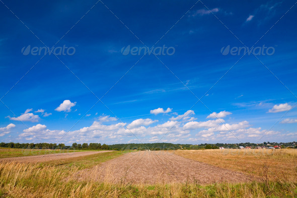 PhotoDune plowed fields and sky 4102163