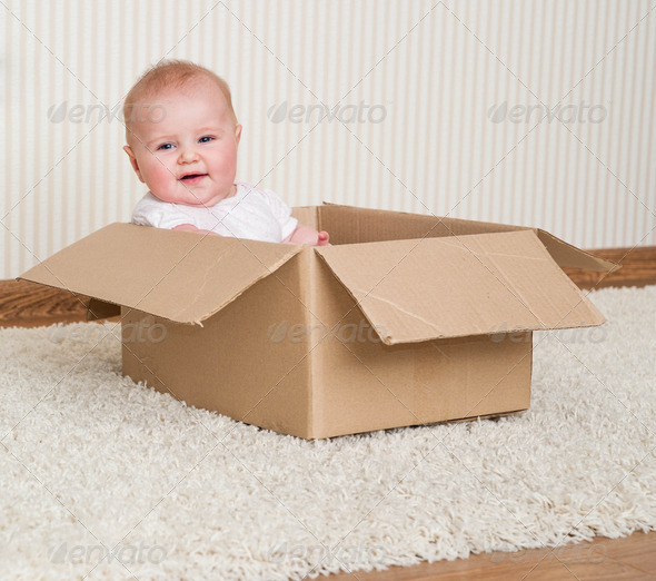 PhotoDune baby girl inside a box 4111895