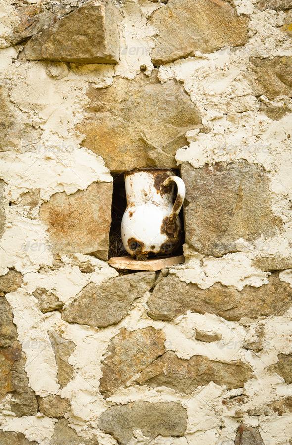 PhotoDune Vintage metalic pitcher in a niche 4112114