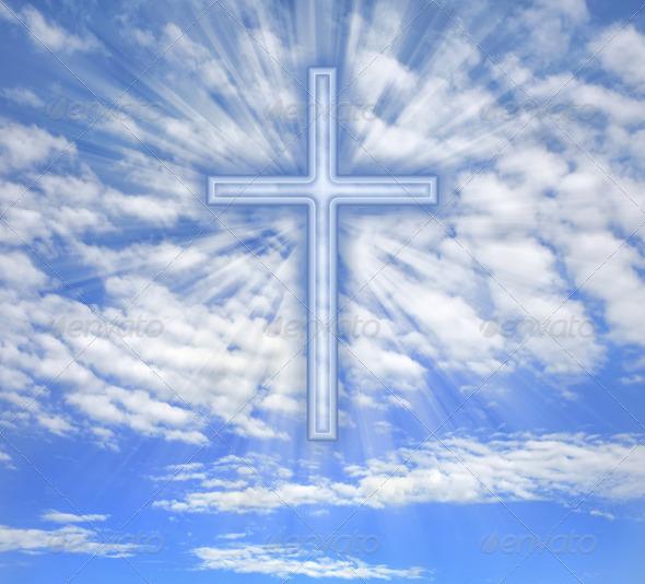 PhotoDune Christian cross with light beams over sky 4124938