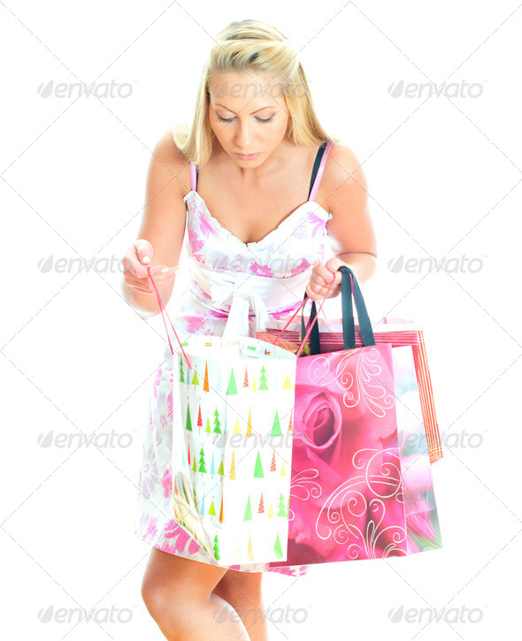 PhotoDune Young pretty woman looking into shop bag Isolated on white 4125006