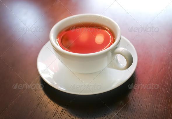 PhotoDune Cup of tea on wooden table macro 4154186