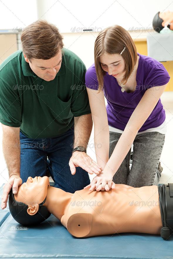 PhotoDune Teen Girl Practices CPR 468411