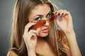 Woman Holding Sunglasses and Looking at You - PhotoDune Item for Sale