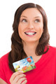 Young pretty woman holding plastic bank card and planning her sp - PhotoDune Item for Sale