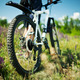 Modern bicycle in meadow with shallow dept of field - PhotoDune Item for Sale