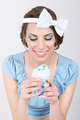 Cute retro woman in blue holding ice-cream - PhotoDune Item for Sale