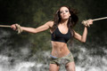 fitness woman with tied arms with smoke and military shorts - PhotoDune Item for Sale