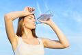Cute young woman drinking water after workout - PhotoDune Item for Sale