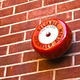 Red fire alarm on brick wall - PhotoDune Item for Sale