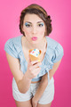 Cute young retro woman eating ice-cream in cornet - PhotoDune Item for Sale