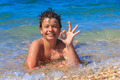 Happy young boy on the sea beach OK - PhotoDune Item for Sale