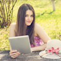 Happy young woman with tablet computer in the park - PhotoDune Item for Sale