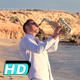 Saxophonist Walking Along Beach - VideoHive Item for Sale