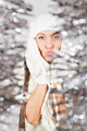 Cute young woman in white among sparkling Christmas decoration - PhotoDune Item for Sale