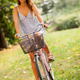Beautiful girl is cycling in a park with a city bike - PhotoDune Item for Sale