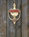 golden doorknocker on a wood door - PhotoDune Item for Sale
