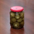 Jar of pickled physalis on a wooden background - PhotoDune Item for Sale