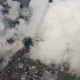 Airplane Flying over City and Clouds - VideoHive Item for Sale
