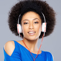 Gorgeous woman listening to music on her earphones - PhotoDune Item for Sale