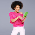 Sexy African American woman with a tablet - PhotoDune Item for Sale
