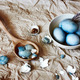 Blue easter eggs in a white plate. Rustic style. - PhotoDune Item for Sale