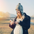 Happy pregnant young woman using smart phone outdoors - PhotoDune Item for Sale