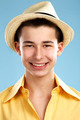 closeup of happy teenager wears hat and yellow shirt - PhotoDune Item for Sale