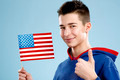 young smiling male student teenager holding a flag - PhotoDune Item for Sale