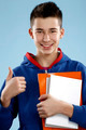 young smiling male student teenager holding a book - PhotoDune Item for Sale