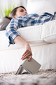 Woman sleeping on sofa with book - PhotoDune Item for Sale