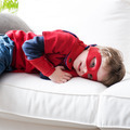 Little superhero resting on sofa - PhotoDune Item for Sale