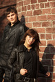 Happy young couple in leather jackets at the brick wall - PhotoDune Item for Sale
