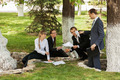Young business people in a city park - PhotoDune Item for Sale