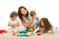 Beauty mom playing with her kids home - PhotoDune Item for Sale