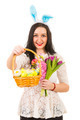 Beauty woman offering basket with Easter eggs - PhotoDune Item for Sale