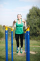 Woman gymnast exercising on parallel bars - PhotoDune Item for Sale