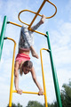 Beautiful young gymnast working out outdoors - PhotoDune Item for Sale