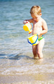 Adorable little boy playing in the sea - PhotoDune Item for Sale