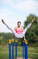 Athletic gymnast exercising on parallel bars - PhotoDune Item for Sale