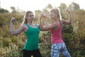 Two athletic girls flexing their arm muscles - PhotoDune Item for Sale