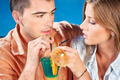 young couple drinking cocktail - PhotoDune Item for Sale